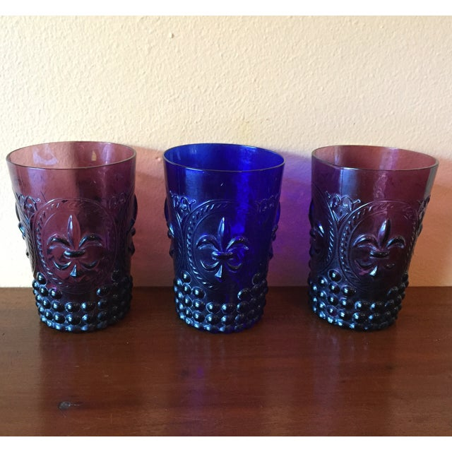 Beautiful set of 3 Deco style pressed glass tumblers, with fleur de lis and hobnail detail. Deeply vibrant colors: 2...