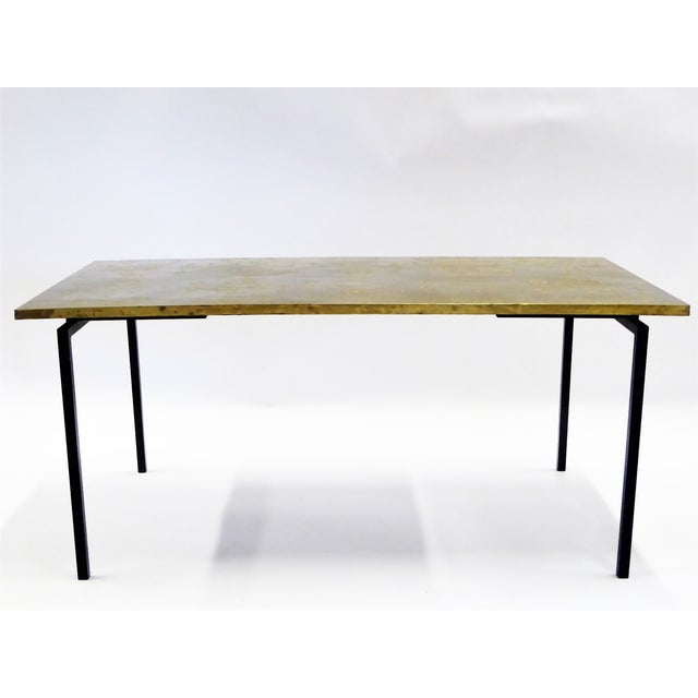 A Raymor Import, this thin line Table features a Brass wrapped Wood Top with a repeating Repoussé design of Angels like...