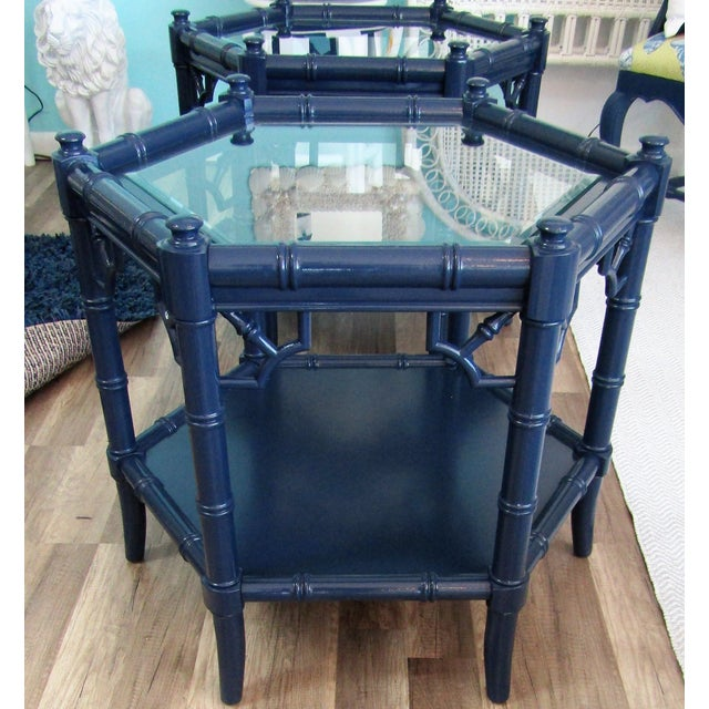 Fabulous pair of side accent tables, faux bamboo with glass tops. The finish is new, navy blue lacquer. The pair are...