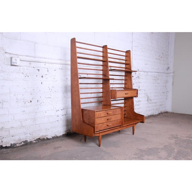 A rare and outstanding mid-century modern self-standing room divider or wall unit designed by Leslie Diamond for Conant...