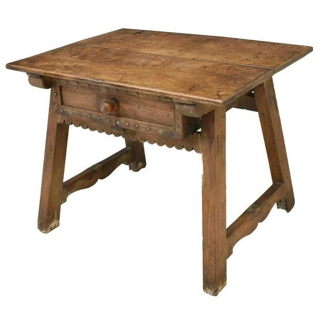 A scarce, Spanish Colonial period low wooden work table with outstanding patina. Hand carved in the early to mid 18th...