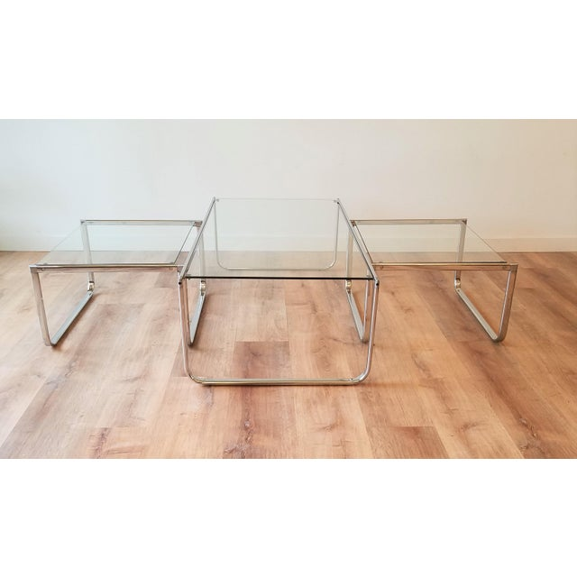 A stunning Italian glass and chrome nesting coffee table. The flexibility of this piece is remarkable from being able to...