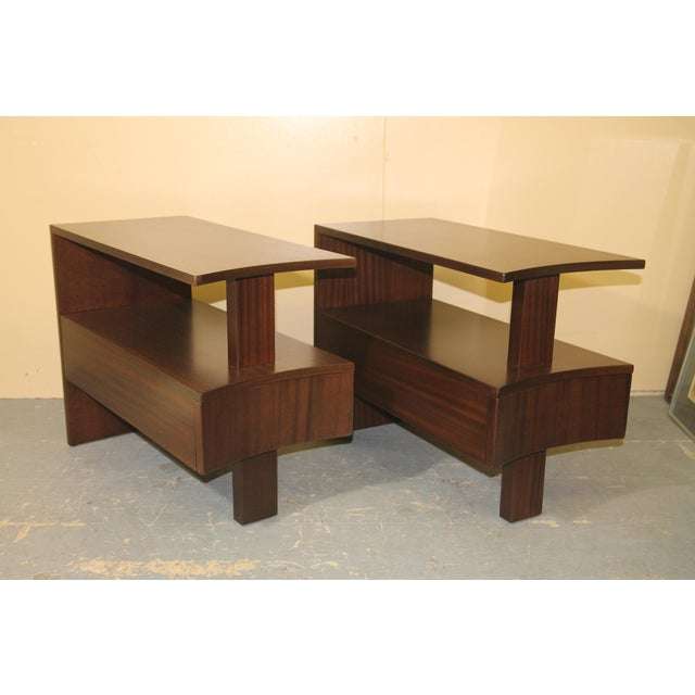 Pictures do not do these amazing and rare African Mahogany side tables from Modernage justice. I have had these beautiful...