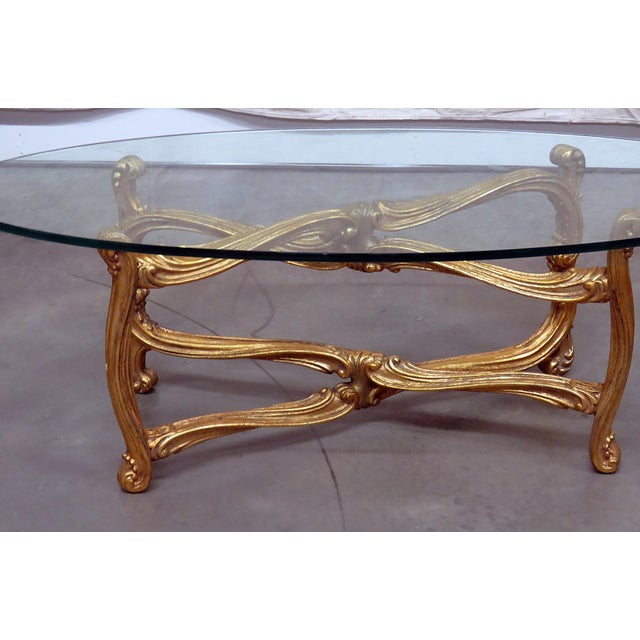 Hollywood Regency distressed painted glass top coffee table.