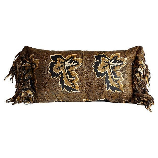 A wonderful warm colored batik cotton fabric piece from Africa made into a tribal modern pillow with hand torn long...