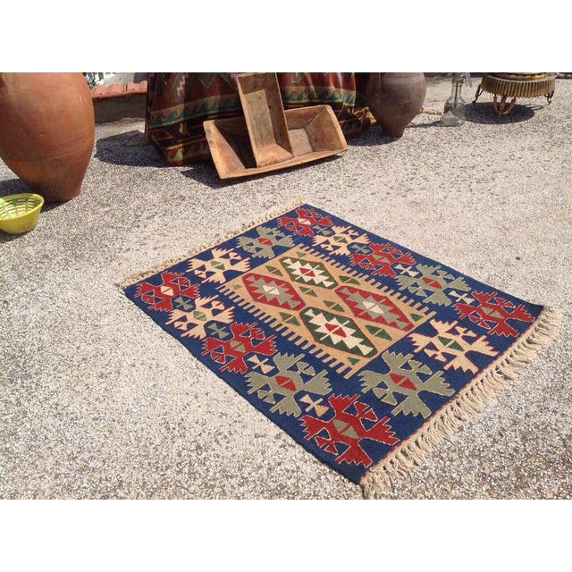 This gorgeous vintage Turkish kilim rug was made of WOOL in 1970`s. It`s professionally cleaned and ready to be a...