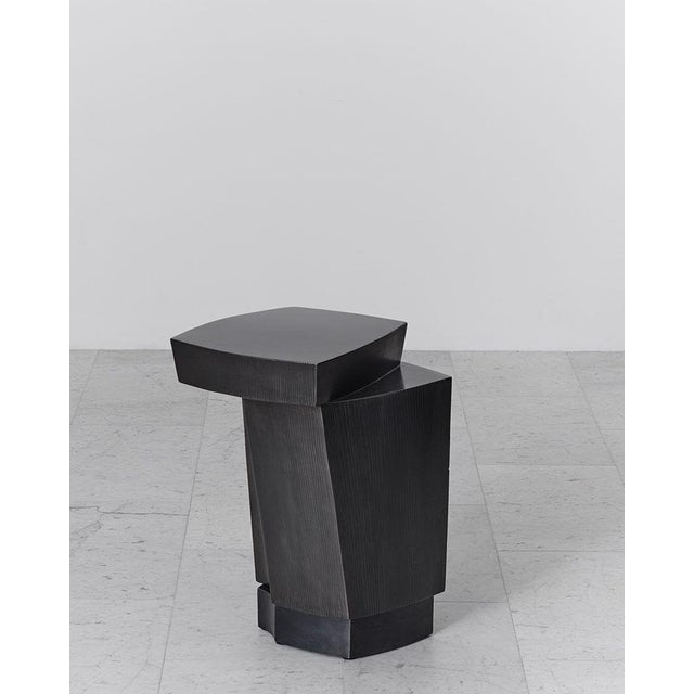 Gary Magakis' handmade blackened steel Ledges 3 Side Table reflects the sculptor's distinct approach to creating bold and...