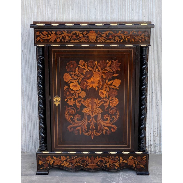 About An exceptional cabinet or encoignures with a marble top above canted corners simulating fluting and solomonic colums...