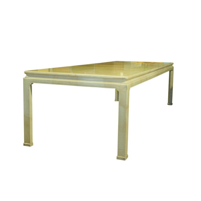Henredon ming style table with a faux marble top. The glossy yellow-ivory faux marble is constructed of acrylic with a...