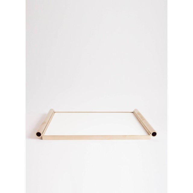 This contemporary tray made of brushed brass and lucite is part of the Orphan Work brand and can be used as an table top...