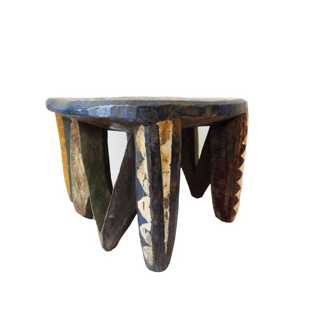 Vintage hand carved of one piece of wood hand-painted stool by the Nupe people in Nigeria. Nupe stools are never...