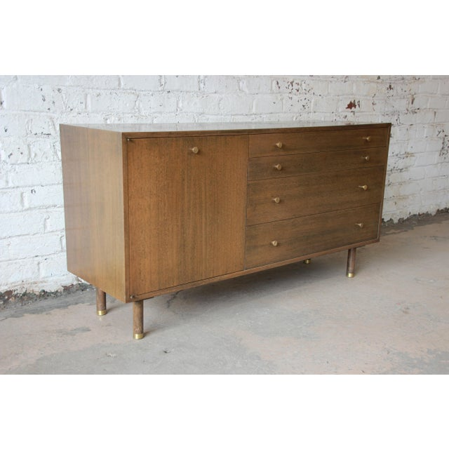 Offering an exceptional Mid-Century Modern credenza designed by Harvey Probber. The credenza features beautiful mahogany...