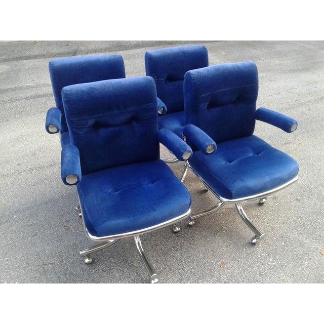 Vintage Hollywood Regency, blue velvet corduroy like fabric with chrome base, arm ends. Swivel base armchairs. Original...