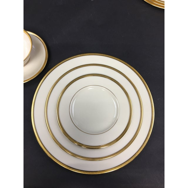 Lenox Tuxedo China. Four 5pc settings. Textured 24k gold banding on a translucent ivory body. Looks as though it has never...