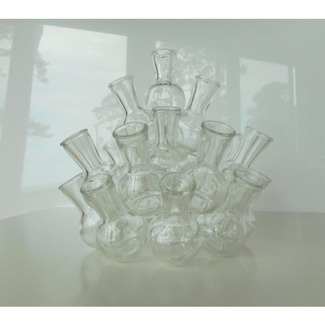 This vintage stacked bud vase has 25 small clear glass bud vases which stack in two separate pieces to form this cluster...