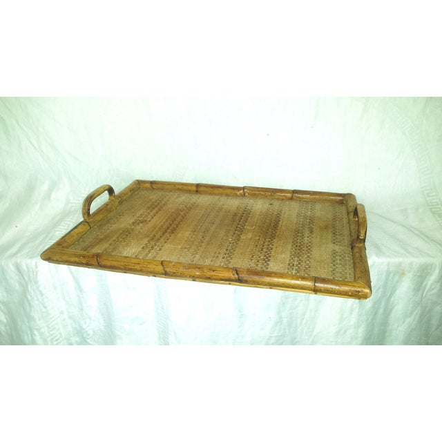 This vintage 1960s bamboo tray has a wonderful patina on it and features two side handles for carrying. Woven grass mat...