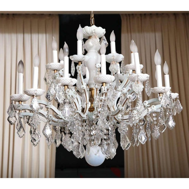With twenty-six (26) candelabra style lights, this magnificent Maria Theresa style chandelier in white glass and clear...