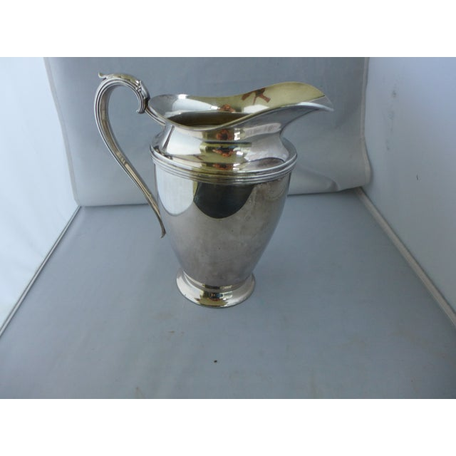 "Vintage, heavy silver-plated water pitcher with maker's mark that reads "" Lynton."" In very good condition; some wear..."