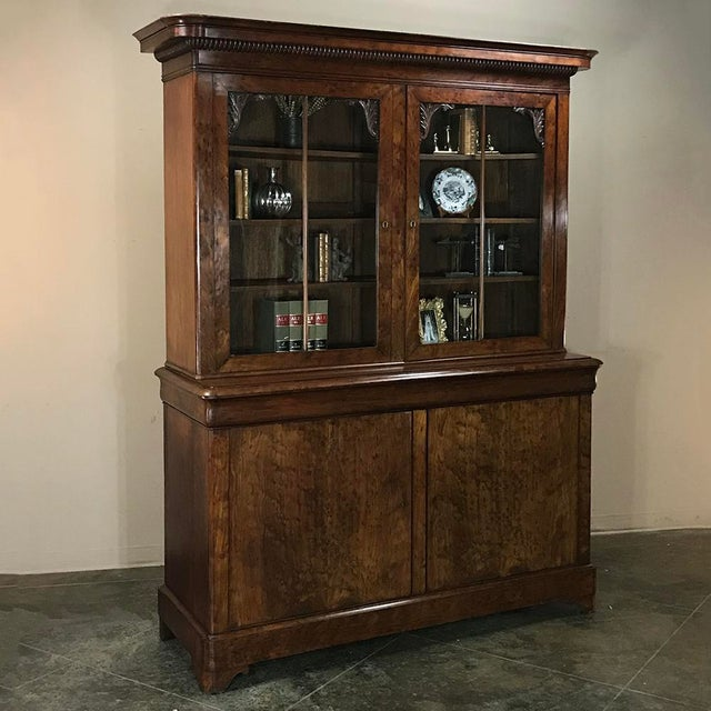 Mid-19th Century Louis Philippe Mahogany Bookcase is a Period piece exemplified by the use of exotic imported mahogany...