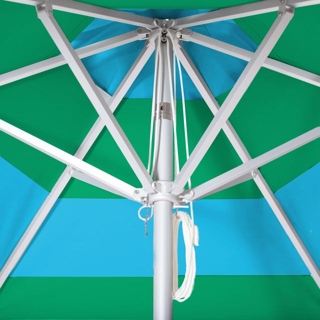The Aruba Daydreams Market Umbrella is a 9' Hexagon in Aluminum. The canopy features a block stripe in Aqua Sea and Erin...