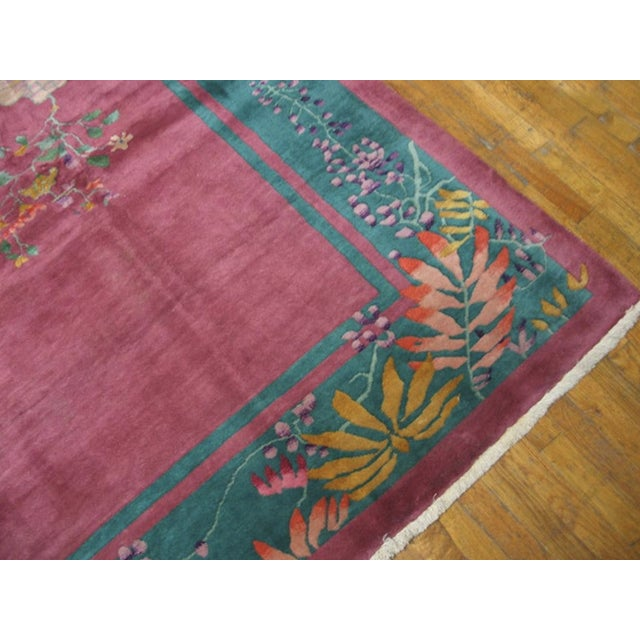 Antique Chinese Art Deco Rug with a red background.