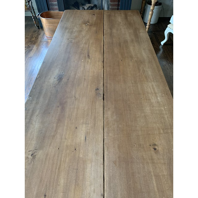 A classic long farmhouse table. Simply constructed. It came from the estate of a collector of English fine art and...