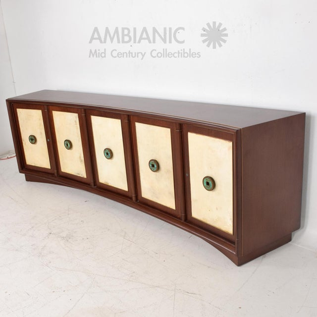 For your consideration a beautiful Credenza with five doors and plenty of storage. The right side has four pull out...