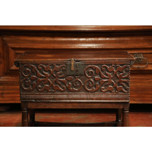 This Classic, antique trunk on stand was carved in France, circa 1780. The sturdy, Baroque style trunk features deep...