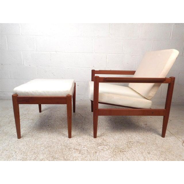 Danish modern lounge chair and ottoman designed by Borge Jensen and manufactured by Bernstorffsminde Mobelfabrik. Sleek...