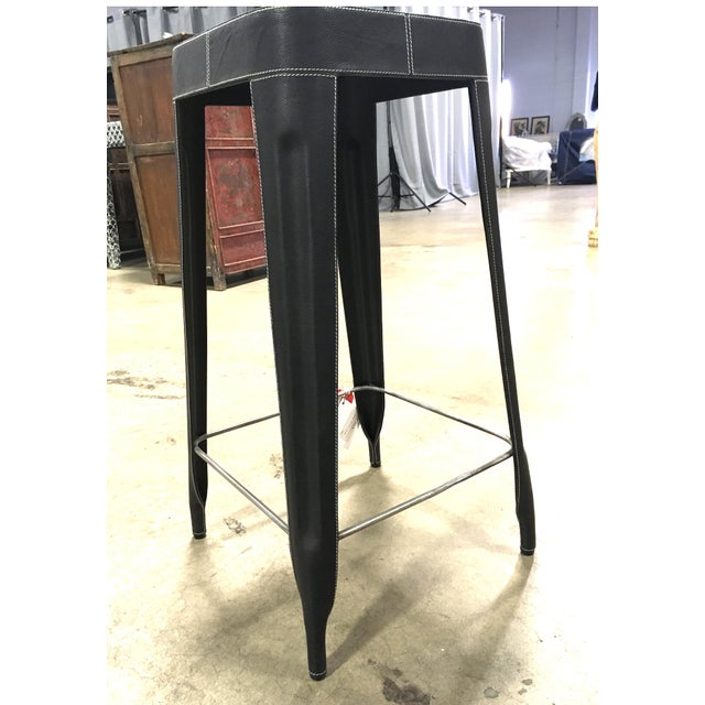 An upgraded version of a traditional bar stool, the easy-to-move bar stool features gorgeous leather with a slight...