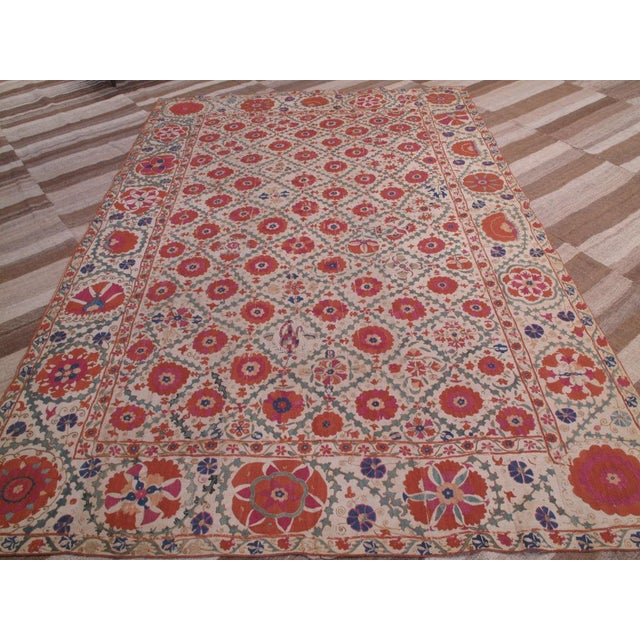 Antique, collectible suzani from Uzbekistan. Pieces like this are associated with wedding customs and are among the most...