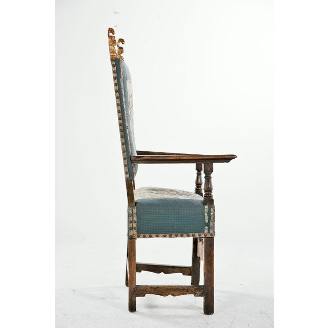 A wonderful early and large Italian or Spanish walnut armchair upholstered with 18th century tapestry. Great gilt wood...