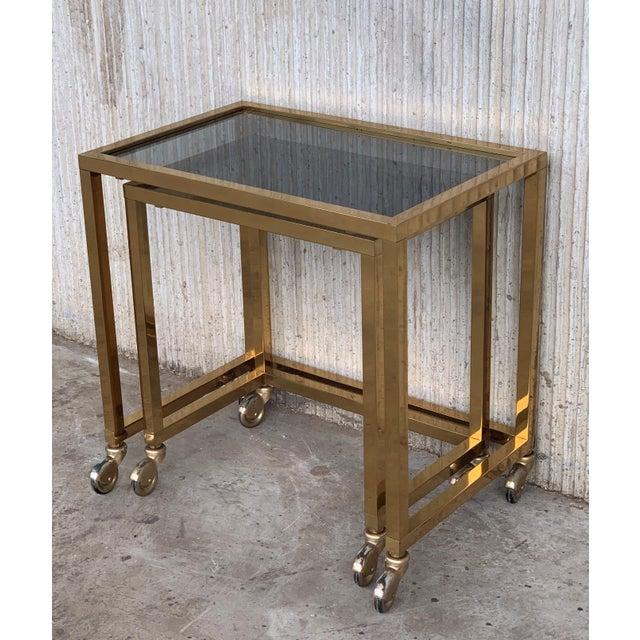 Nesting Tables Italian Design 1970 in Brass With Smoked Glass and Wheels - a Pair For Sale - Image 9 of 11