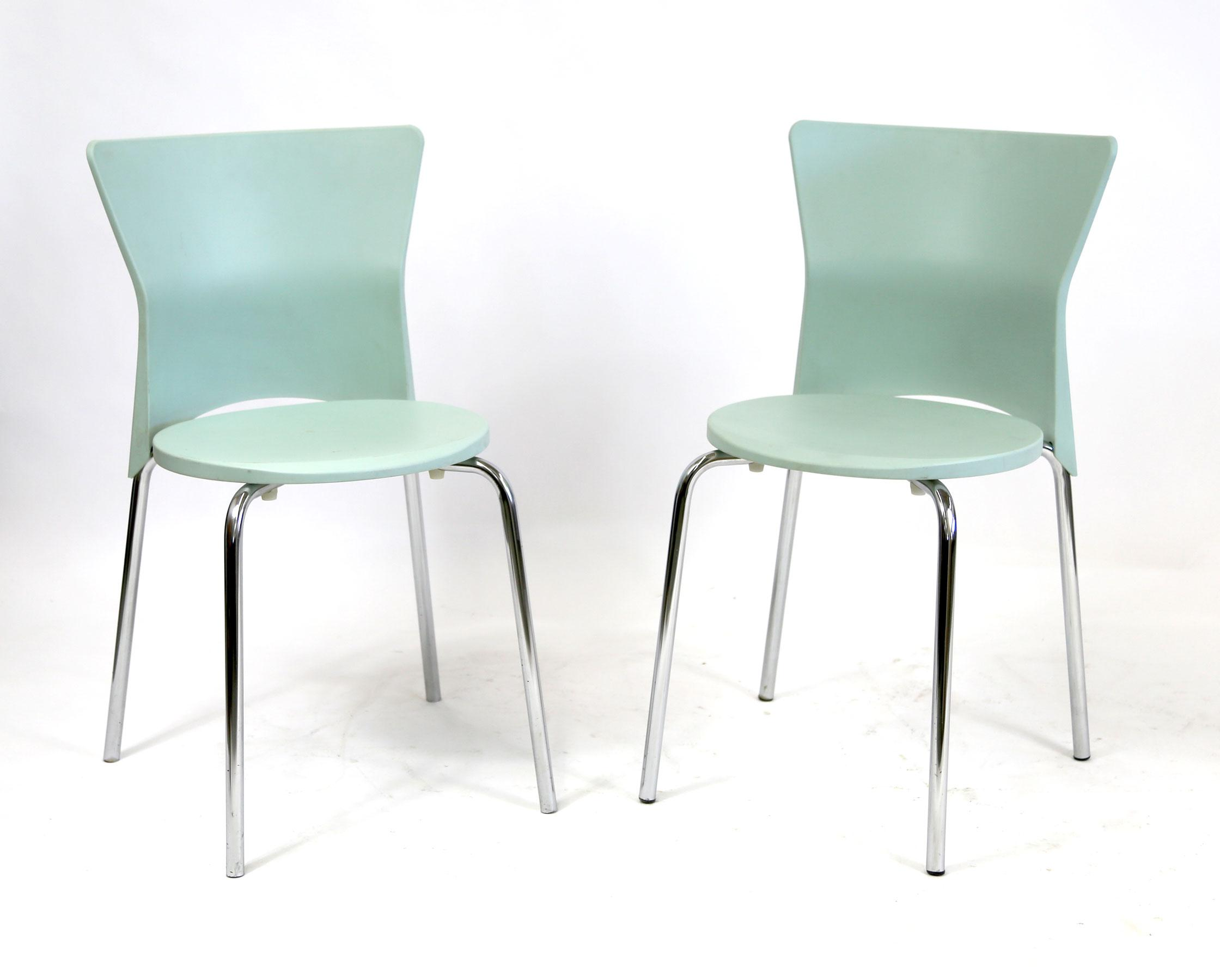 A Quirky Pair Of Dark Blue Side Chairs With A Plastic Blue Shell Seat And  Metal