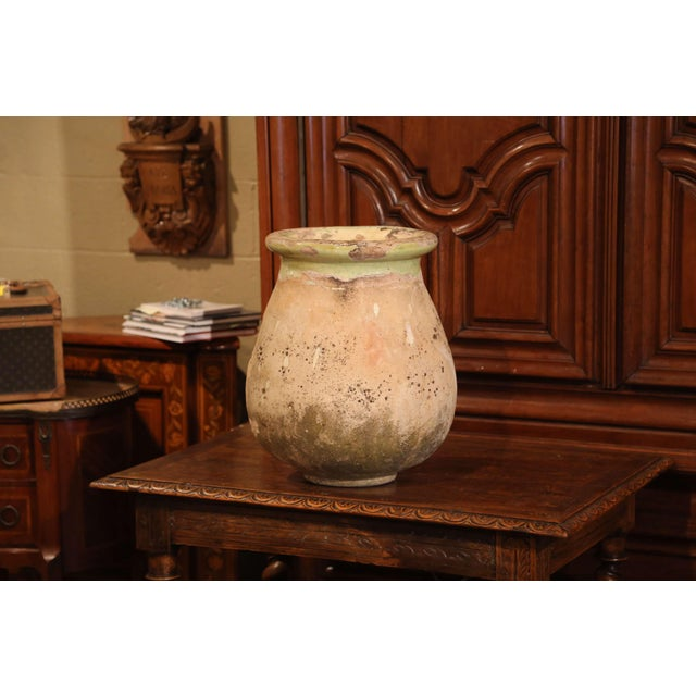 This antique earthenware olive jar was created in Southern France, circa 1860. Made of blond clay and neutral in color,...