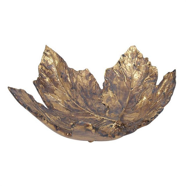 The Antique Gold Maple Leaf tray takes on the realistic form of an autumn maple leaf. The details are enhanced by its...