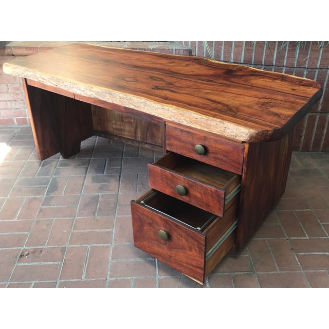 Mid-century modern large wood slab desk offers 2 live edges, convex front, 5 drawers and a pull-out writing surface. What...