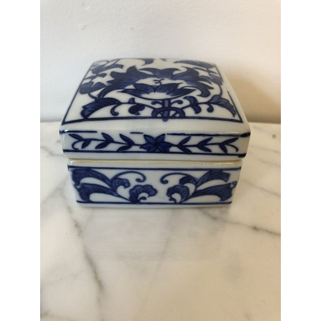 Beautiful blue and white ceramic chinoiserie style box; Square in shape. Piece is perfect for holding jewelry, coins, or...