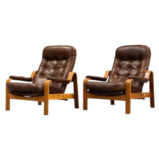 Pair of Danish Teak and Leather Lounge Chairs For Sale