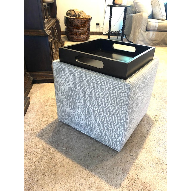 Nelson F50-000 Storage ottoman in the fabric 49679-10. Flips over as a try to hold glasses and drinks. Spend $450 new....