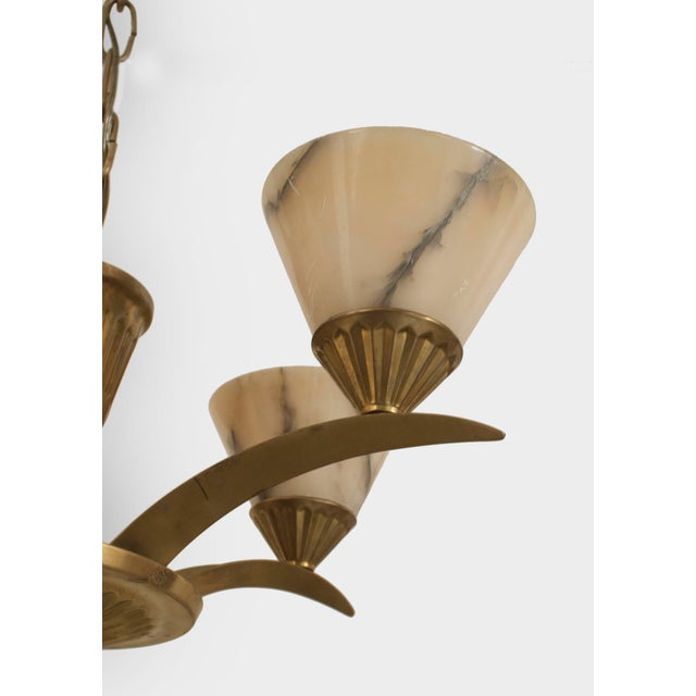 French Art Deco brass (circa 1925) chandelier with 5 flaired arms emanating from a cone form center and supporting conical...