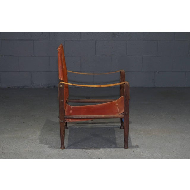 Red leather Safari chair by Kaare Klint for Rud Rasmussen.