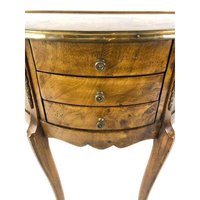 Gorgeous burlwood demilune commode having brass frame around the top, lovely brass embellishments, 3 drawers, elegant...