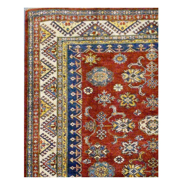 This beautiful Kazak rug is hand made, %100 wool pile, made in Afghanistan. It features a pattern in a vibrant combination...
