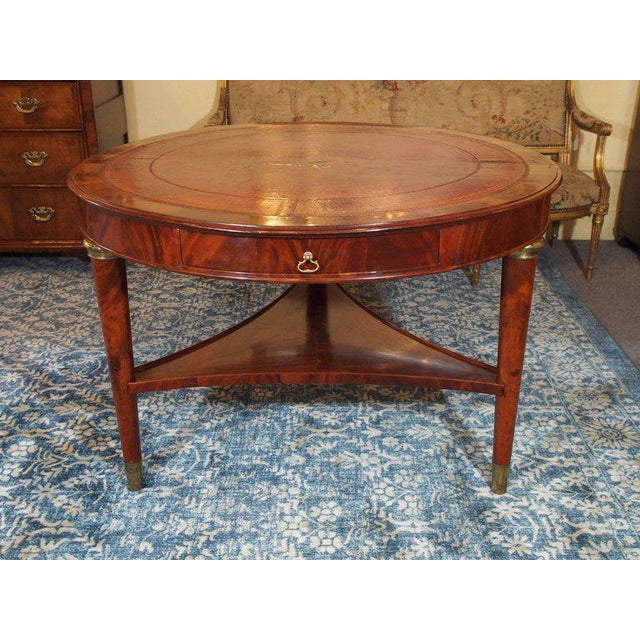 Antique French Louis Philippe mahogany leather top drum table, circa 1840.