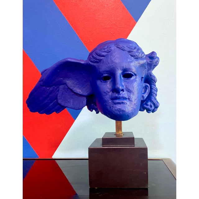Beautiful mounted reproduction of the head of Hypnos the Greek god of sleep. This plaster sculpture was sold by the...