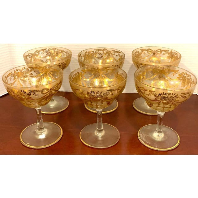 Set of six gilt enameled frosted grand coupes/ dessert or seafood, with raised gilt neoclassical gilt decoration....