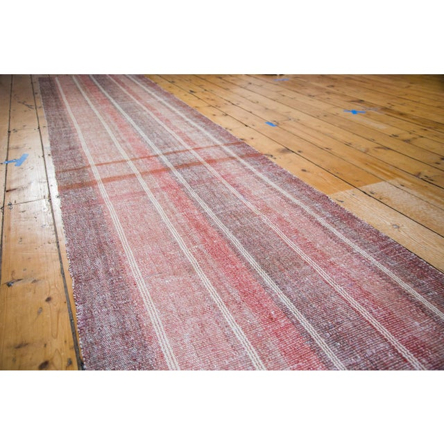 Newer rug runner in varying shades and striations of soft rose reds and wine burgundy. Flat woven Kilim construction...