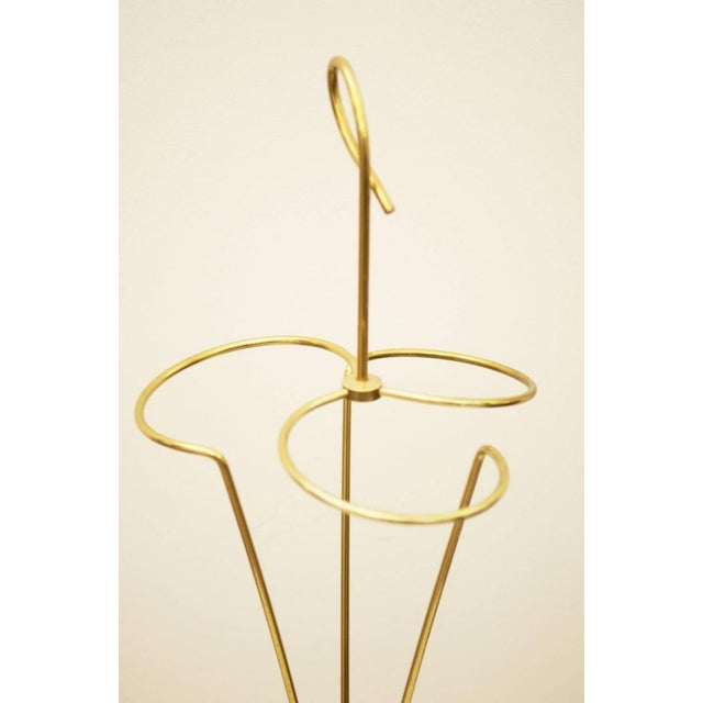 This umbrella was made in Vienna and consists of a cast iron foot with brass umbrella holder.