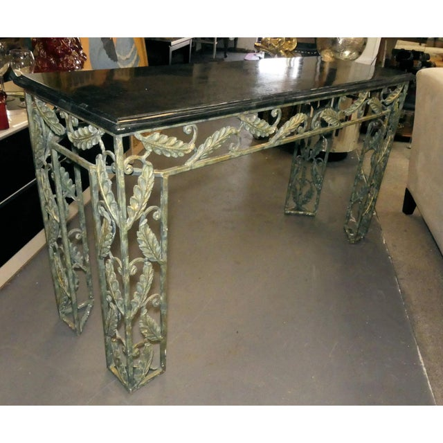 A beautifully designed Maitland Smith console table. Lovely botanical leaf design on all sides, along the apron and down...